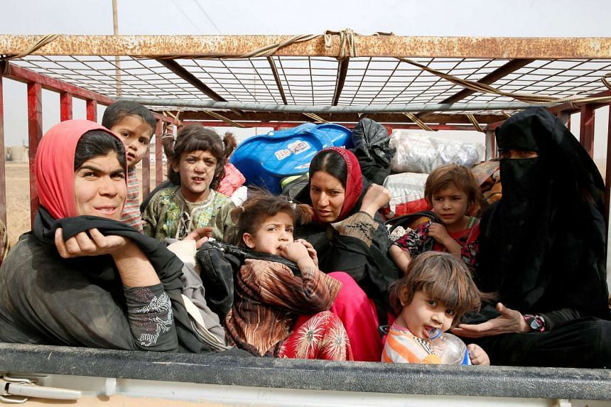 Displaced Iraqi women and children escaping from the village of Abu Jarboa, near Mosul, on Nov 1, 2016.