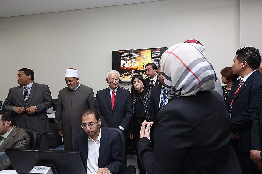 President Tan touring the Al Azhar Observatory for Foreign Languages in eastern Cairo - a key institution in Egypt's battle against religious extremism - on Monday afternoon with Parliamentary Secretary for Trade and Industry Low Yen Ling (second fro