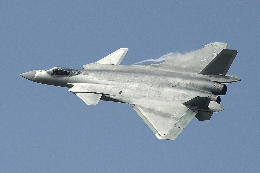 China's new J-20 stealth fighter at the Zhuhai air show, in Guangdong province, yesterday.