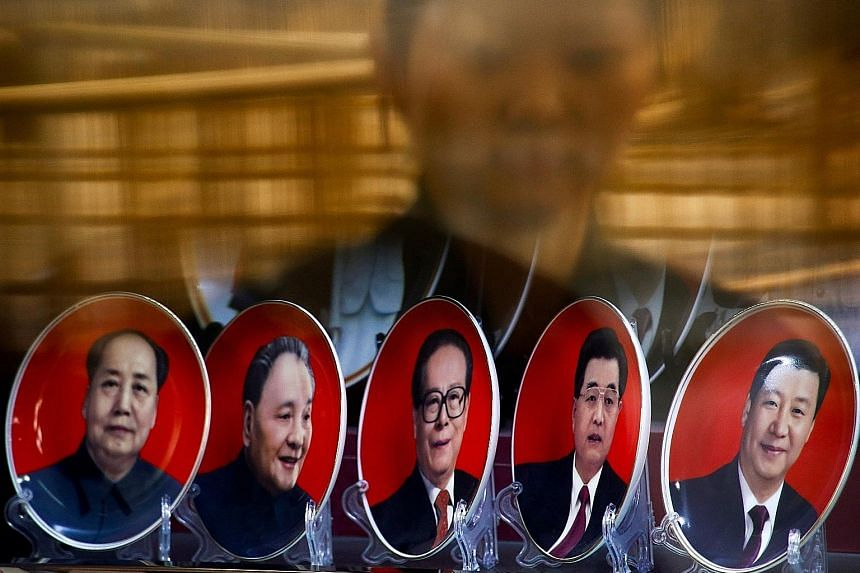 """Souvenir plates with portraits of Chinese leaders past and present (from left) Mao Zedong, Deng Xiaoping, Jiang Zemin, Hu Jintao and Xi Jinping. Mr Xi has officially been designated as the party's """"core"""" leader, a status that is expected to give him"""