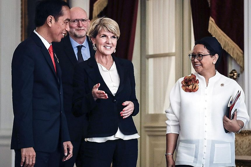 Australian Foreign Minister Julie Bishop (centre) with Indonesian President Joko Widodo (left) and Foreign Minister Retno Marsudi in Jakarta on Oct 26. Ms Bishop told ABC Radio yesterday the South China Sea patrols would be designed to exercise the r