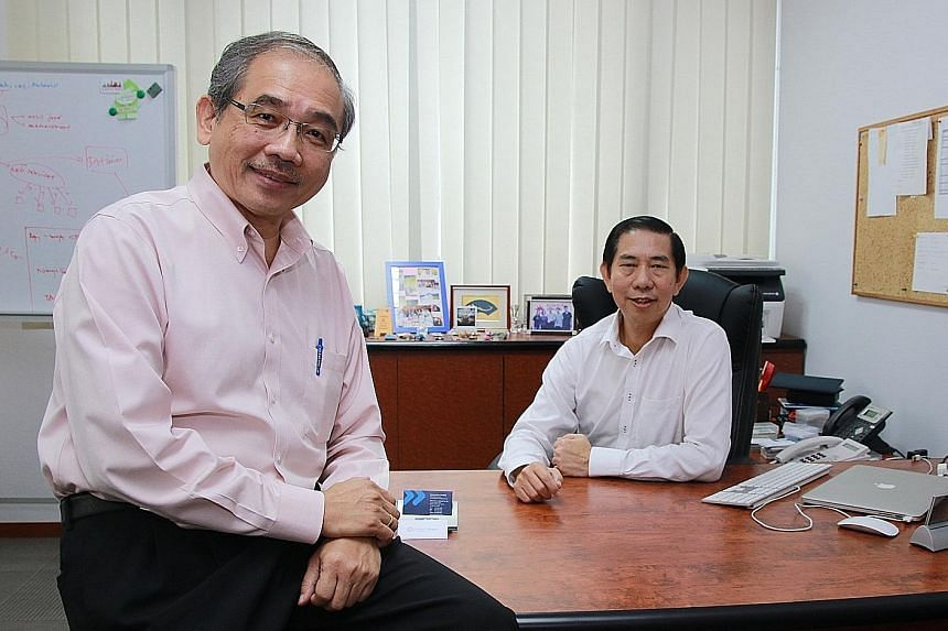 Mr Chiang (right) and Mr Kuek head Whizcomms, the new kid on the block for fibre broadband.