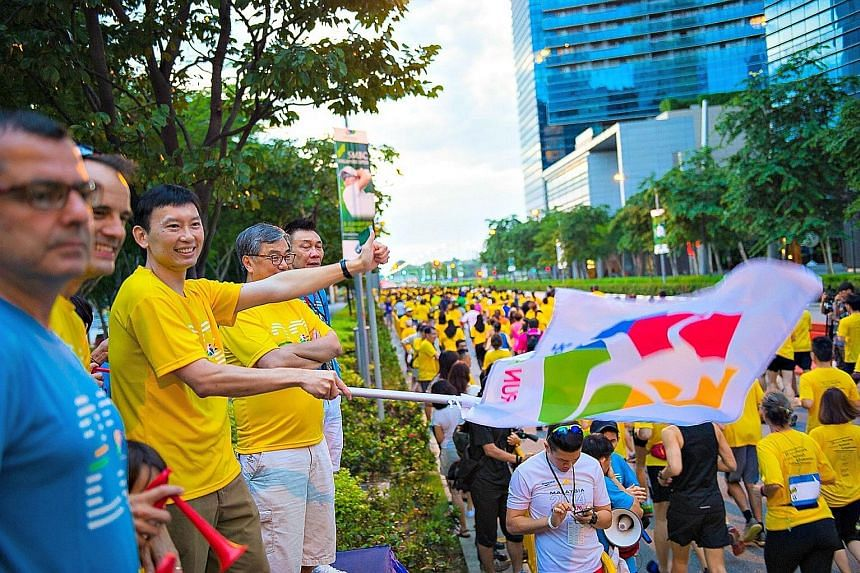 Runners being flagged off at Run For Hope 2016 at The Promontory @ Marina Bay on Jan 31. The event, which has raised over $2.4 million since 2008 for cancer research and awareness, will return on Feb 19.