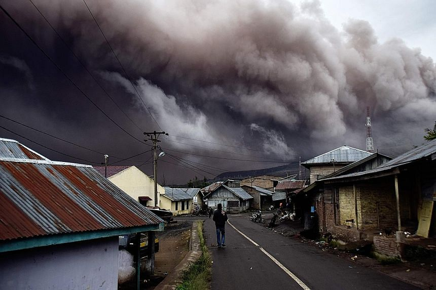 Residents in Karo regency on Sumatra island were on edge yesterday, with a rumbling Mount Sinabung spewing volcanic ash that reached as high as 1km. The volcano, which began erupting on Sunday, has prompted the authorities to bar tourists from enteri