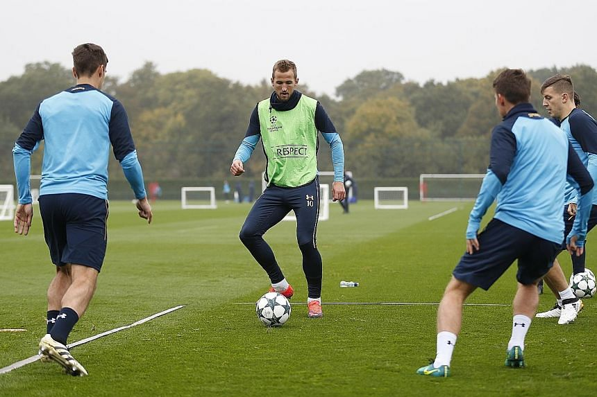 Tottenham's Harry Kane training with team-mates yesterday ahead of their Champions League clash with Leverkusen at Wembley. The Englishman's return cannot come soon enough for his side, who have struggled up front without him. In a tight group, they