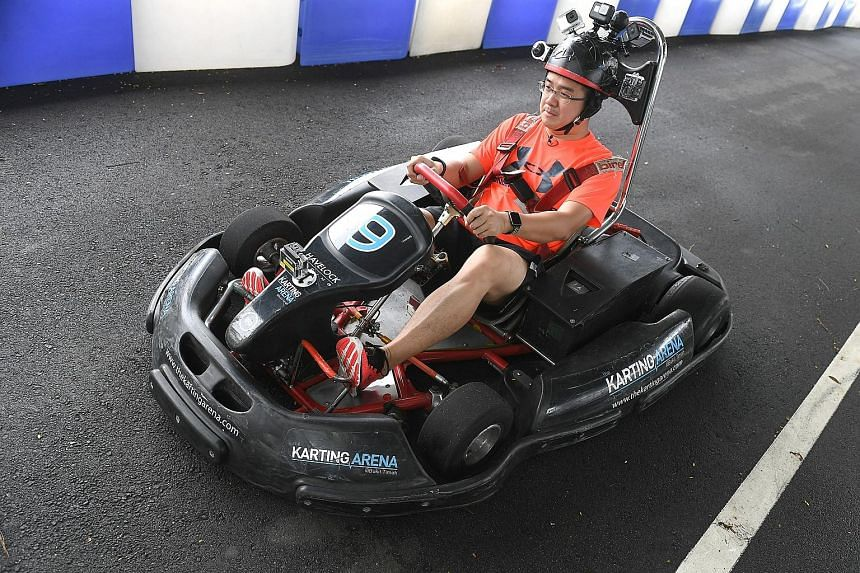 The writer trying out six action cameras while go-karting at the Karting Arena.