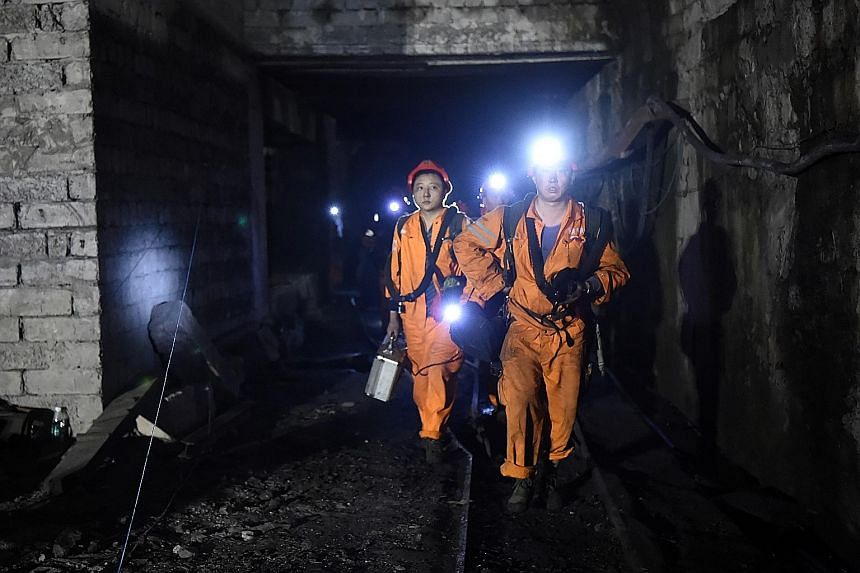 Rescuers exiting the mine in Chongqing on Monday. More than 400 rescuers were digging through the underground passageways, some of which had been blocked by ruins from collapsed tunnels.