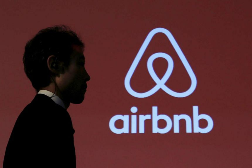 A man walks past a logo of Airbnb after a news conference in Tokyo, Japan, on Nov 26, 2015.