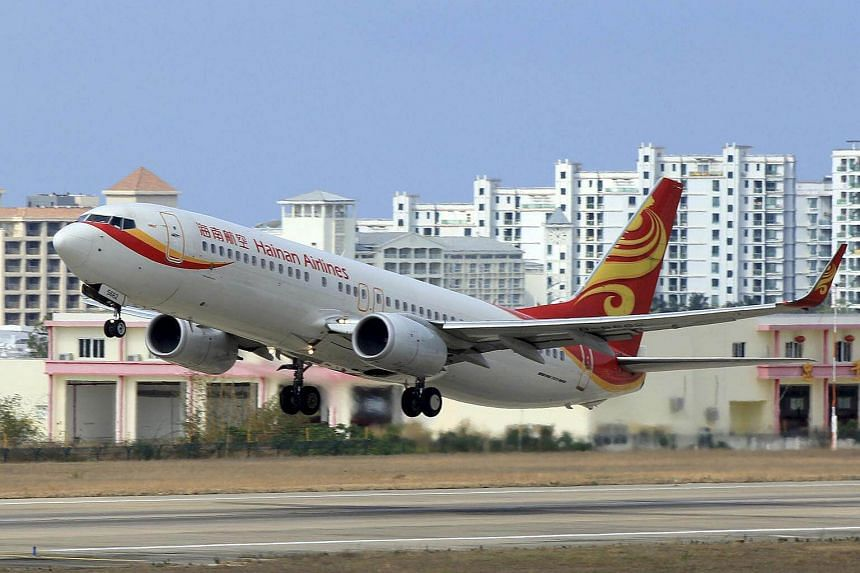 A Hainan Airlines plane takes off from the Sanya Phoenix International Airport in Sanya, China.