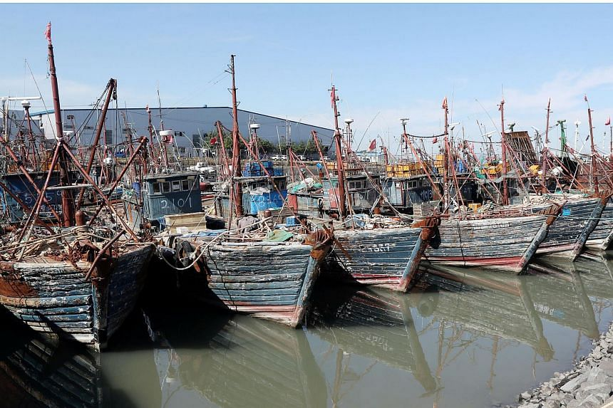 Chinese fishing boats captured by South Korean coast guards are seen at a port in Incheon, South Korea, on Oct 10, 2016.