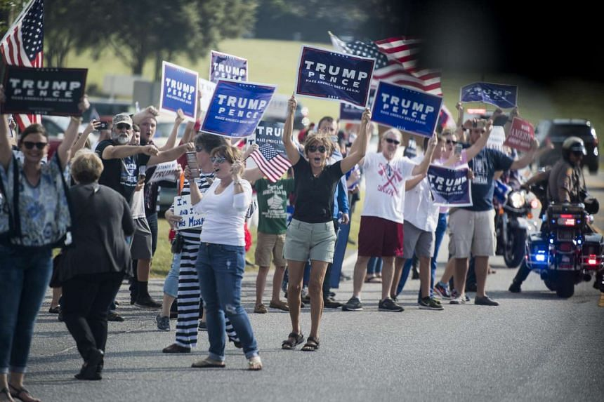 Supporters of Donald Trump and Mike Pence rally near an event for Hillary Clinton in Florida.