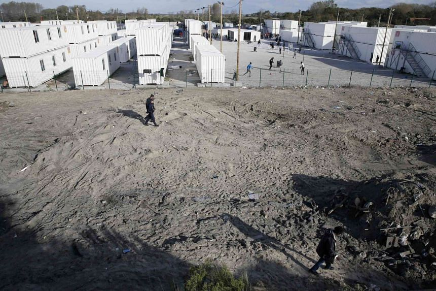 """A general view shows the area with containers used as temporary housing for migrants who are minors in the """"Jungle"""" during the dismantlement of the camp in Calais, France on October 27."""