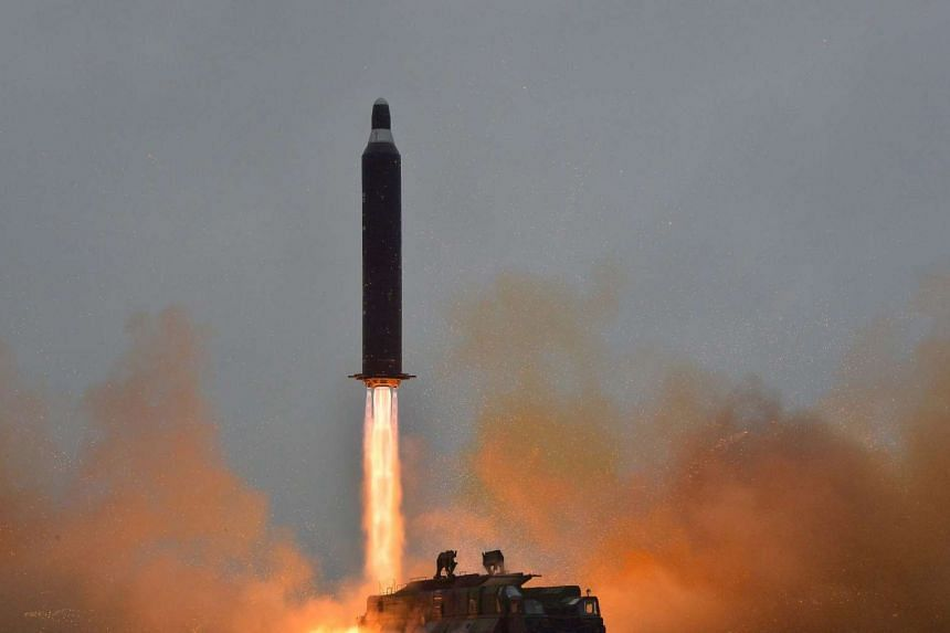 An undated file picture provided by the Korean Central News Agency (KCNA), the state news agency of North Korea, shows a surface-to-surface medium long-range strategic ballistic rocket Hwasong-10, also known by the name of Musudan missile, being laun