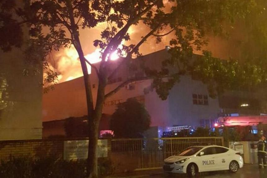 The fire broke out in what appeared to be a warehouse building at 65 Sungei Kadut Loop.