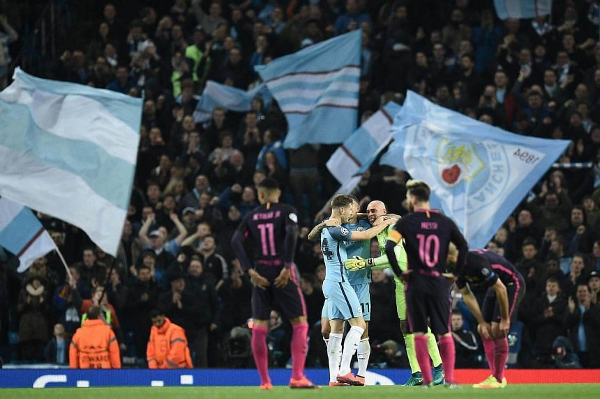 Neymar (left) and Lionel Messi (right) react as Manchester City's players celebrate.