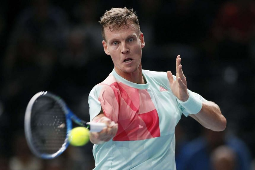 Tomas Berdych of Czech Republic returns the ball to Joao Sousa of Portugal during their second round match for the BNP Paribas 2016 Masters tennis tournament in Paris.