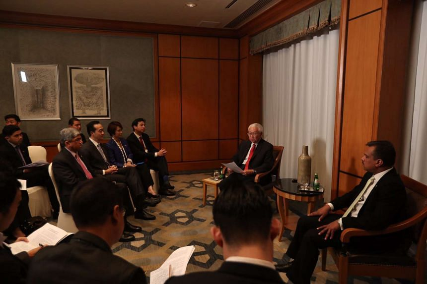 President Tony Tan Keng Yam speaks to the media and the Singapore delegation. Seated on Dr Tan's left is Singapore Ambassador to Egypt S. Premjith.