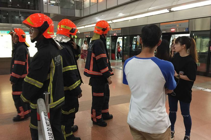 SCDF officers looking out for the safety of the train passengers at Marymount MRT station.