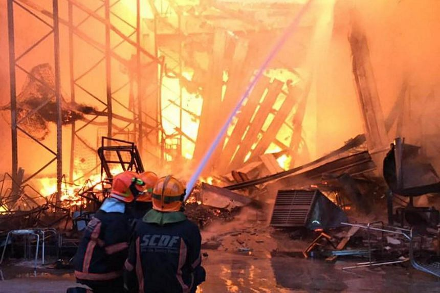 The onset of the fire at a three-storey warehouse on 65 Sungei Kadut Loop. SCDF said the fire had engulfed the entire building.