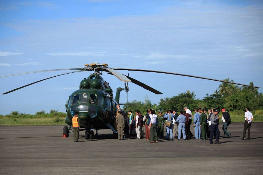 Senior diplomats from the UN, United States, China, Britain, the European Union and India board a helicopter in Sittwe to visit the troubled Rohingya villages in the Maungdaw area in northern Rakhine State in Myanmar.