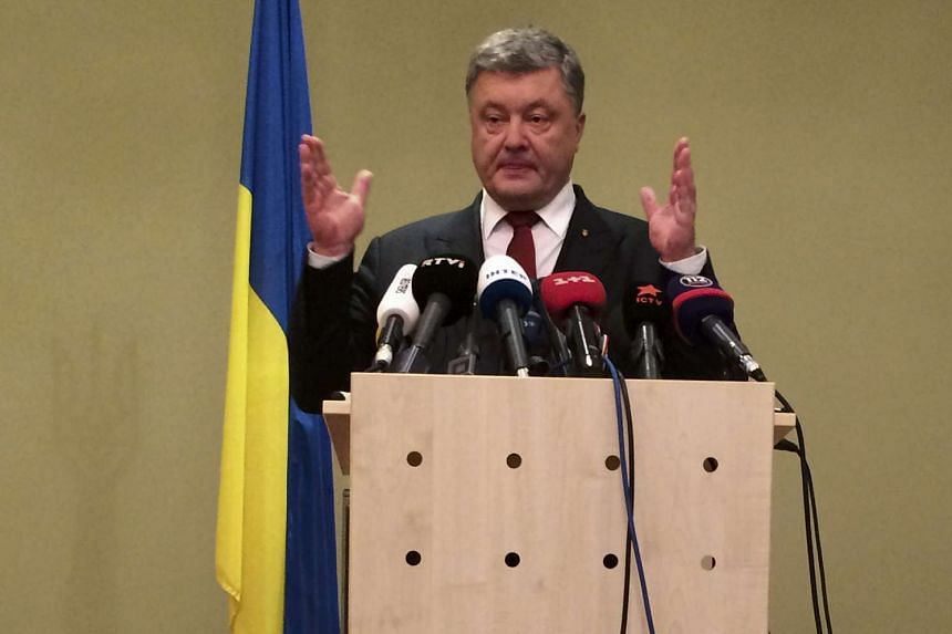 Ukrainian President Petro Poroshenko makes a statement after talks on a stalled peace plan in Berlin, Germany on Oct 20, 2016.