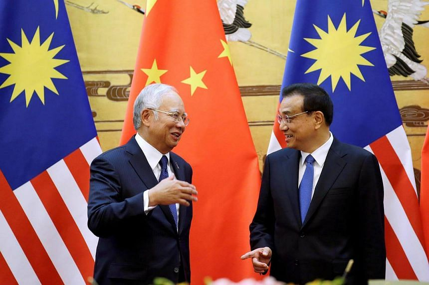 Malaysia's Prime Minister Najib Razak and China's Premier Li Keqiang attend a signing ceremony at the Great Hall of the People, in Beijing.