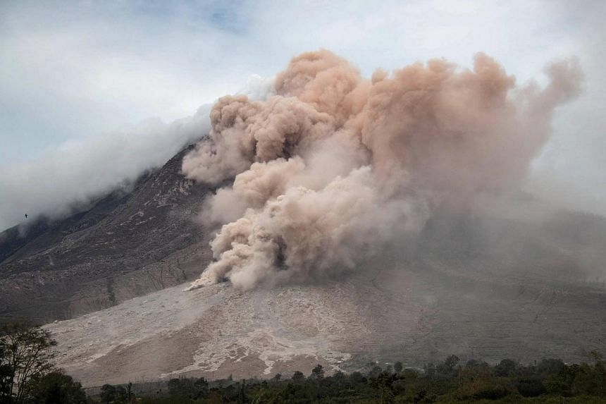 Mount Sinabung on Sumatra island is seen from Karo unleashing gas and fine rock during a volcanic eruption on Oct 31, 2016.