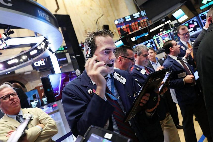 Traders work on the floor of the New York Stock Exchange on Nov 1, 2016.