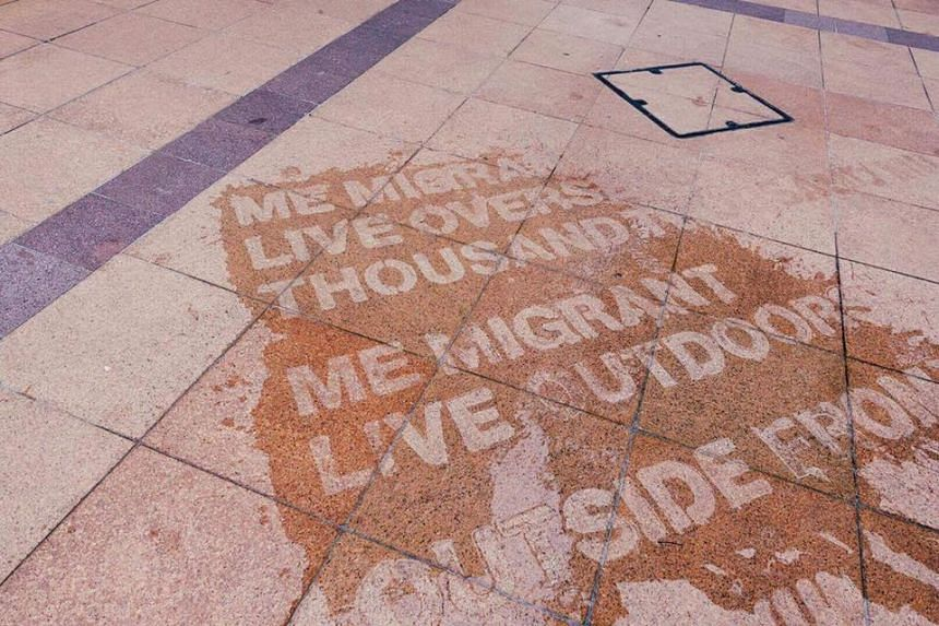 """Using a specially formulated waterproof spray, non-profit Sing Lit Station has """"hidden"""" poetry on pavements of the Esplanade."""