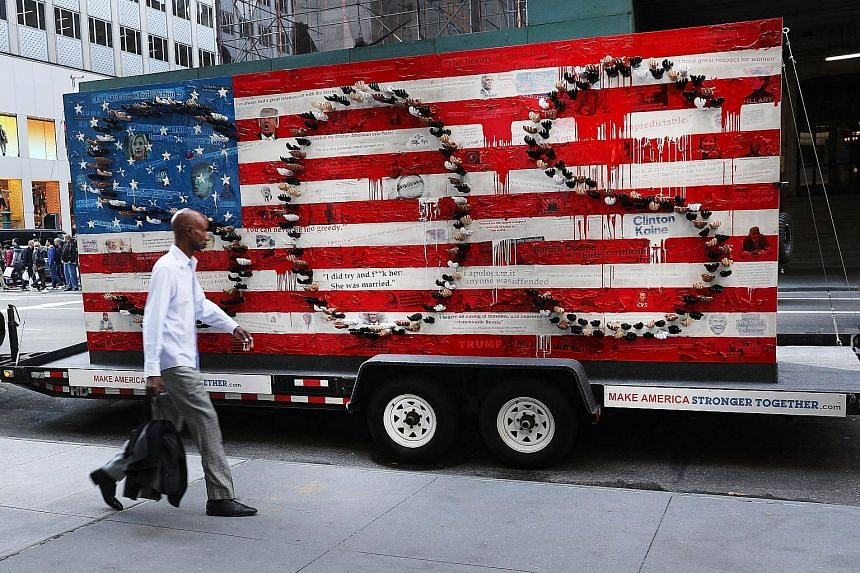 A rolling art installation commenting on the state of politics in America sits in the road in Manhattan.