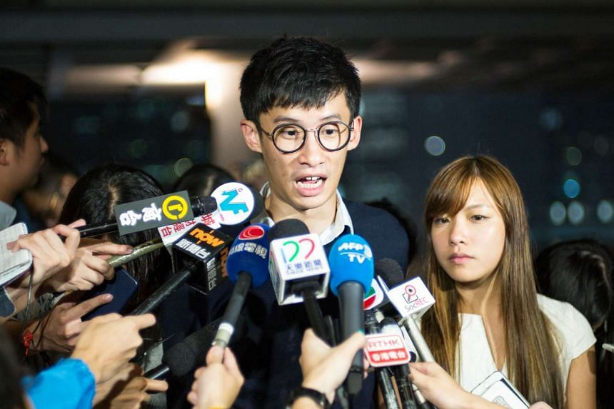 Newly-elected pro-independence lawmakers, Baggio Leung (center) and Yau Wai-ching speak to the press outside the High Court in Hong Kong on Oct 18, 2016.