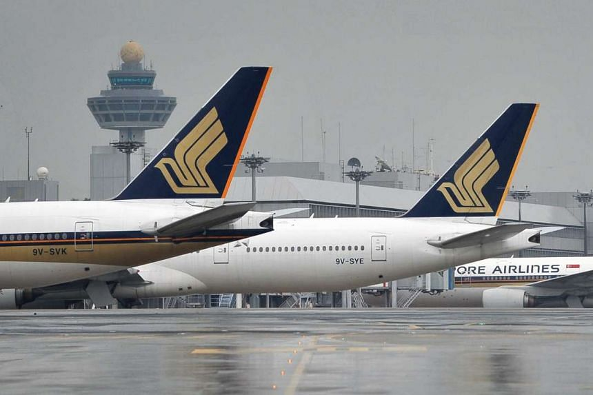 Singapore Airlines planes lined up at the Changi Airport on April 21, 2012.