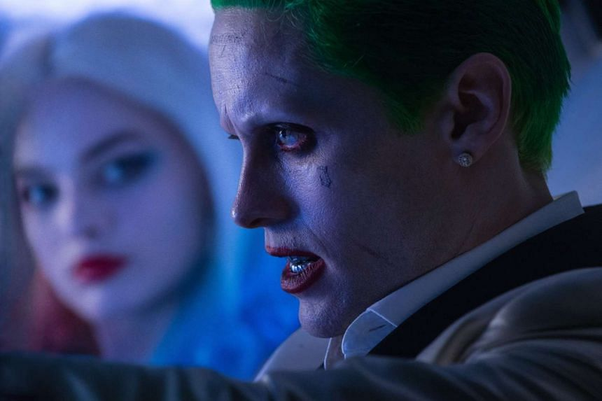 Cinema Still of Suicide Squad, starring Jared Leto (right) as the Joker and Margot Robbie (left) as Harley Quinn.