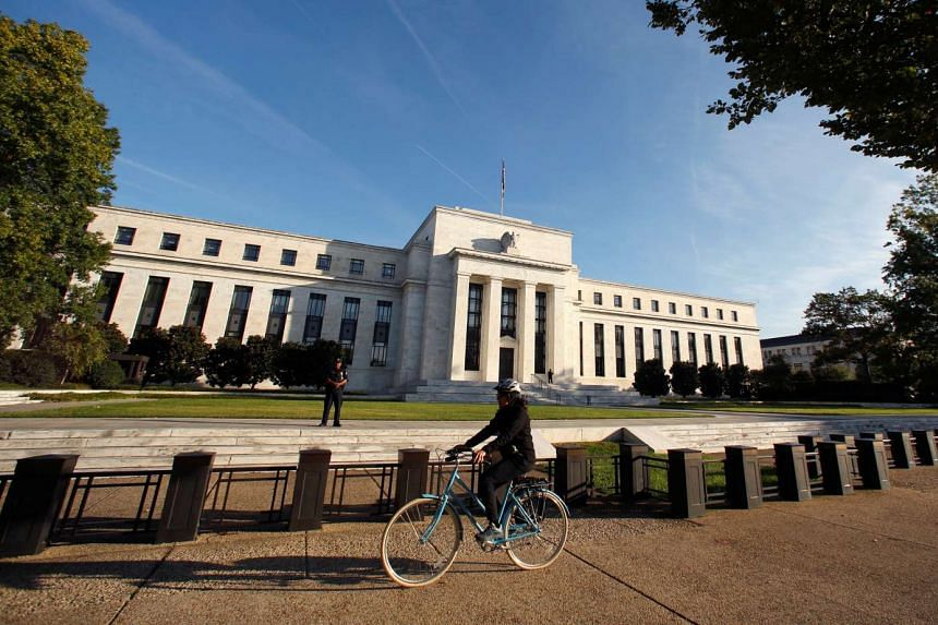 A cyclist passes the U.S. Federal Reserve in Washington on Oct 12, 2016.