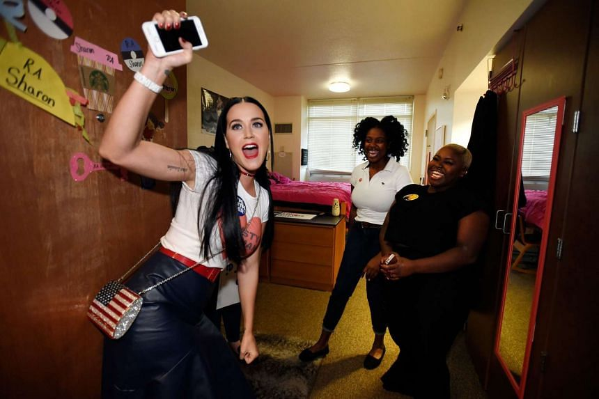 Katy Perry canvasses for Democratic presidential candidate Hillary Clinton in dorm rooms at UNLV on Oct 22, 2016, in Las Vegas, Nevada.