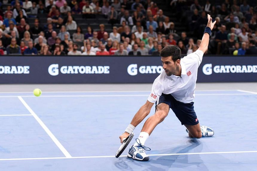 Serbia's Novak Djokovic returns the ball during the first round doubles match with Serbia's Nenad Zimonjic against France's Quentin Halys and Adrian Mannarino at the ATP World Tour Masters 1000 indoor tennis tournament in Paris on Oct 31, 2016.