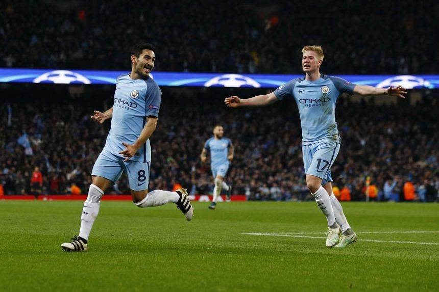 Manchester City's Ilkay Gundogan celebrates scoring their third goal with Kevin De Bruyne at the Champions League Group Stage in Etihad Stadium, Manchester, England.