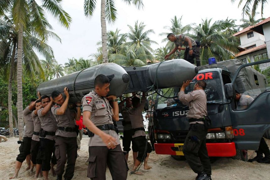 Police prepare a boat for a search and rescue operation after a boat capsized off Batam.