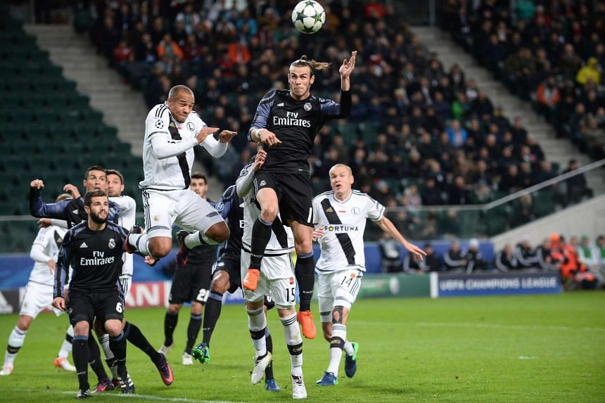 Real Madrid's Gareth Bale and Legia Warsaw's Vadis Odjidja vie for the ball during the Uefa Champions League group F football match between Legia Warsaw and Real Madrid.