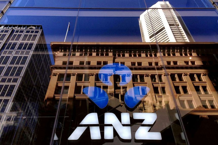 The logo of the ANZ Banking Group is displayed in the window of a newly opened branch in central Sydney, Australia.