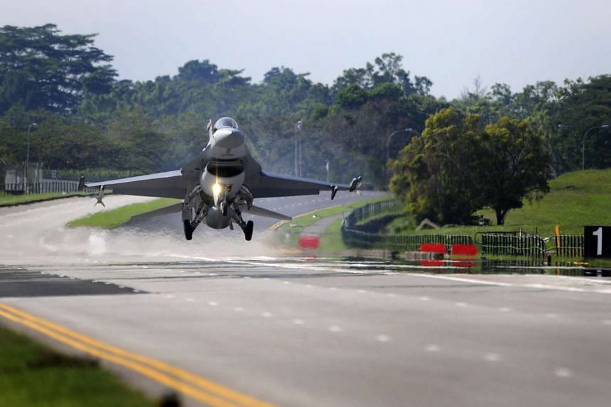 A F-16 fighter jet prepares to land on the Lim Chu Kang road during Exercise Torrent, a military exercise held by the Republic of Singapore Air Force (RSAF) on Nov 29, 2008.