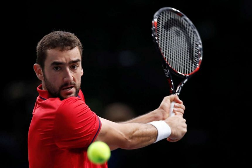 Croatia's Marin Cilic returns a shot to Belgium's David Goffin during their Paris Masters match on Nov 3, 2016.
