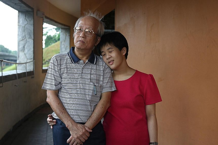Mr Chong's daughter Wan Shuen has a mild intellectual disability, but through the school-to-work transition programme, she has found work at the linen department of the National University Hospital.