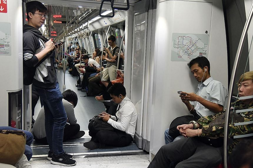Passengers waiting inside a stationary train at Marymount MRT station yesterday. SMRT said preliminary findings revealed a communications glitch similar to the one which disrupted service on the Circle Line for a week in August.