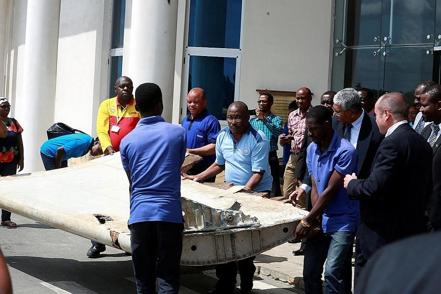 """The aircraft wing suspected to be part of missing Malaysia Airlines Flight MH370 was discovered on the island of Pemba, off the coast of Tanzania. Investigators found the plane was likely to have been """"in a high and increasing rate of descent"""" when i"""