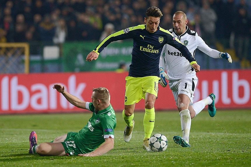 Arsenal's Mesut Ozil outfoxing the Ludogorets defence before scoring an 88th-minute winner in the Champions League clash. The German dinked the ball over 'keeper Milan Borjan, and left two defenders on their backsides before passing the ball into the