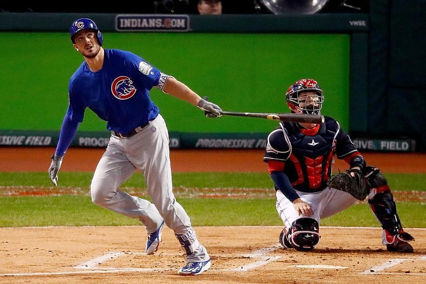 Cubs third baseman Kris Bryant hits a solo home run during the first inning to give Chicago a 1-0 lead in Game 6 of the World Series. The Cubs ended up 9-3 winners on Tuesday to set up Game 7.