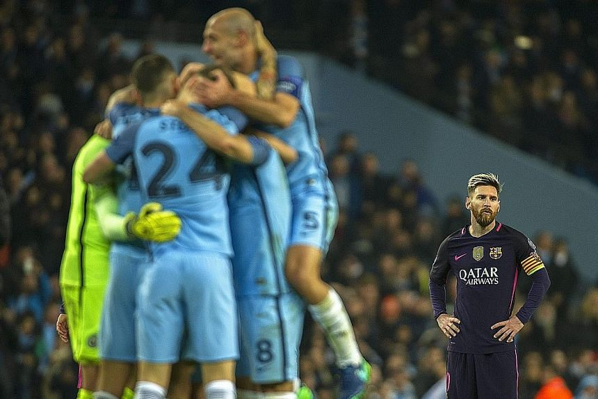 Barcelona star Lionel Messi (right) reacts to his side conceding a goal. The Argentinian put the visitors ahead but Manchester City hit back with three goals.