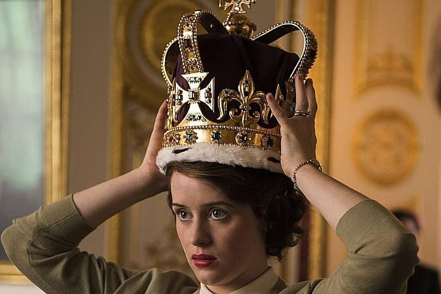 Queen Elizabeth II (played by Claire Foy, left) is made queen at the age of 25 after her father, King George VI, dies of lung cancer.
