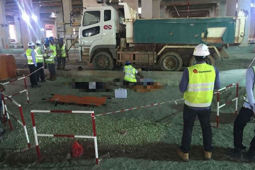 Two workers were killed when a truck reversed over them at a worksite in Mandai on Nov 3, 2016.